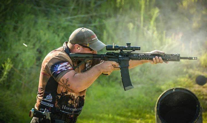 Garrett Grover shooting his rifle at a recent 3-gun event.  Rise Armament Triggers