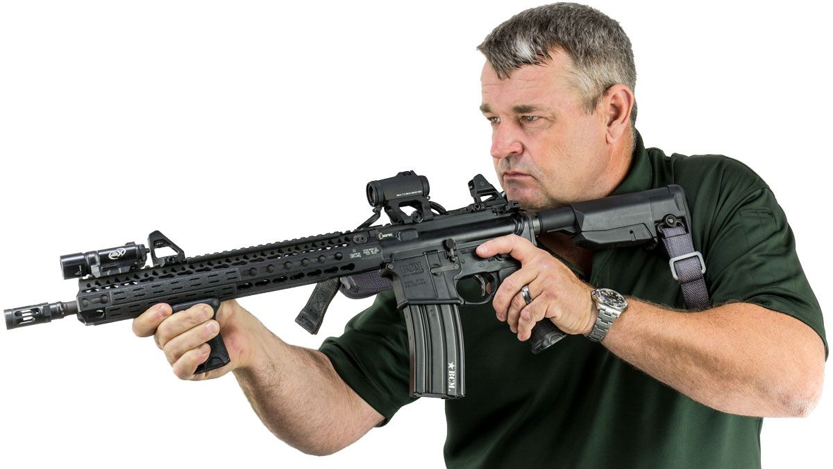 Larry Vickers with a BCM Carbine fitted with an Aimpoint and a pair of Scalarworks Peak Iron sights.